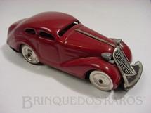 1. Brinquedos antigos - Schuco - Sedan Patente vinho Made in US Zone Década de 1950
