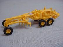 1. Brinquedos antigos - Umex - Motoniveladora Caterpillar, com 12,00 cm de comprimento. Década de 1960