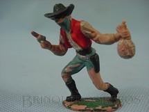 1. Brinquedos antigos - Casablanca e Gulliver - Bandido andando com revolver e saco de dinheiro