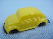1. Brinquedos antigos - Sem identificação - Volkswagen Sedan com 6,00 cm de comprimento amarelo brinde Toddy Década de 1960