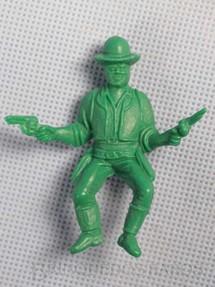 1. Brinquedos antigos - Casablanca e Gulliver - Cowboy montado a cavalo com dois revolveres de plástico verde Década de 1980