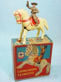 1. Brinquedos antigos - Estrela - Cavalinho Teimoso com Cowboy 9,00 cm de altura Caixa datada 02-06-1970