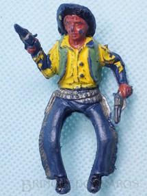 1. Brinquedos antigos - Casablanca e Gulliver - Cowboy montado a cavalo com dois revolveres Plástico azul escuro pintado Década de 1960
