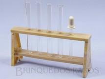 1. Brinquedos antigos - Guaporé - Suporte de plástico marmorizado com 4 Tubos de ensaio de vidro e um Conta-gotas para Conjunto de Química Década de 1960