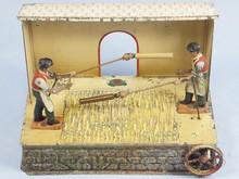 Brinquedos antigos -  - Padeiros debulhando trigo com 20,00 cm de comprimento fabricado pela Doll Alemanha em lata Brinquedo movido por uma Caldeira à Vapor Década de 1920.