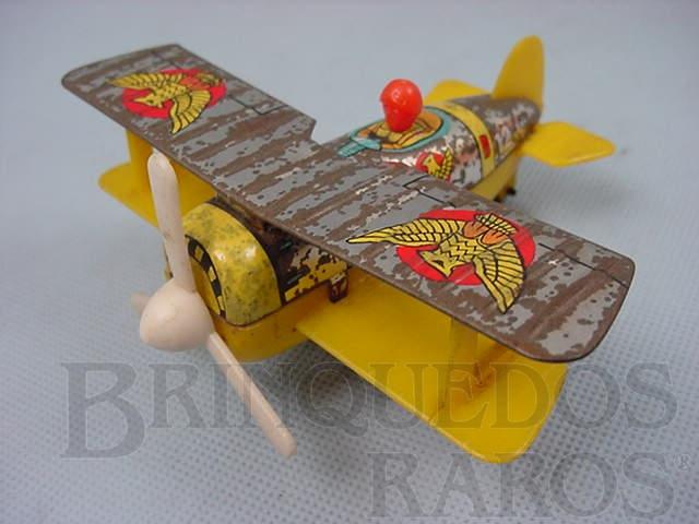 Brinquedo antigo Avião biplano de lata e plastico