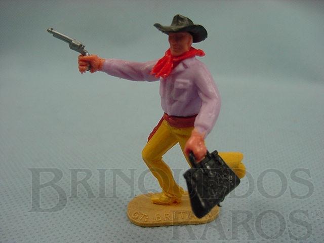 Brinquedo antigo Bandido à pé com revolver e maleta