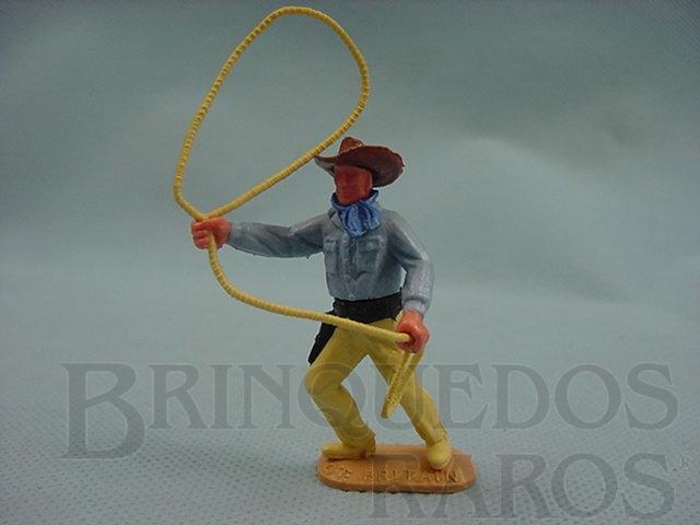 Brinquedo antigo Cowboy de pé com laço