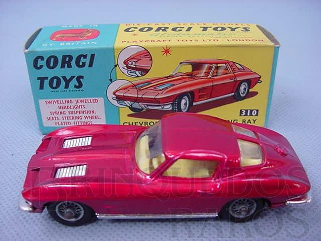 Brinquedo antigo Chevrolet Corvette Sting Ray vermelho metálico