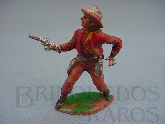 Brinquedo antigo Cowboy de pé com revolver