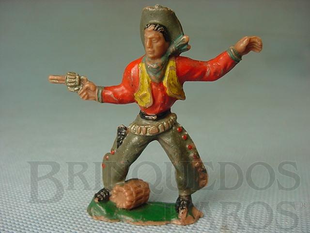 Brinquedo antigo Cowboy de pé atirando com revolver Barril na base Falta o Cactus Casablanca numerado 119