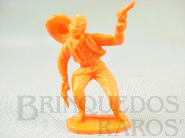 Brinquedo antigo Cowboy baleado de plástico laranja Década de 1980