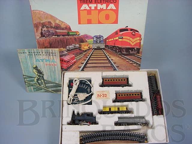 Brinquedo antigo Conjunto de Locomotiva a vapor dois Carros de Passageiros dois Vagões de Carga trilhos e Transformador Década de 1960
