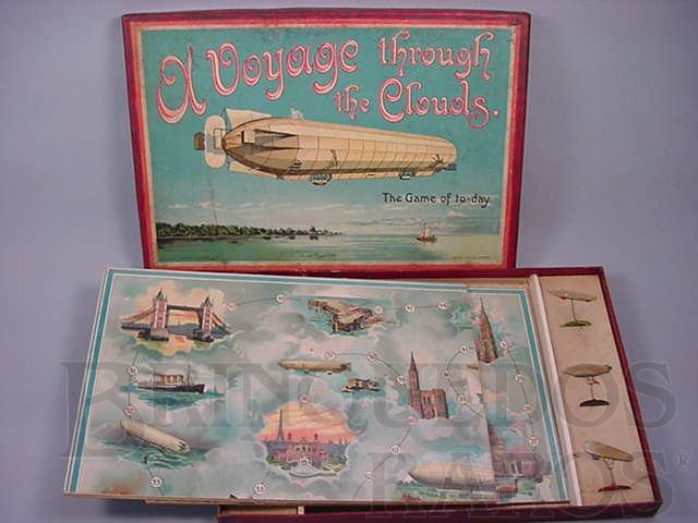 Brinquedo antigo Jogo com seis Dirigíveis de chumbo com 6,00 cm de comprimento A Voyage Througt The Clouds The Game of To Day Década de 1920