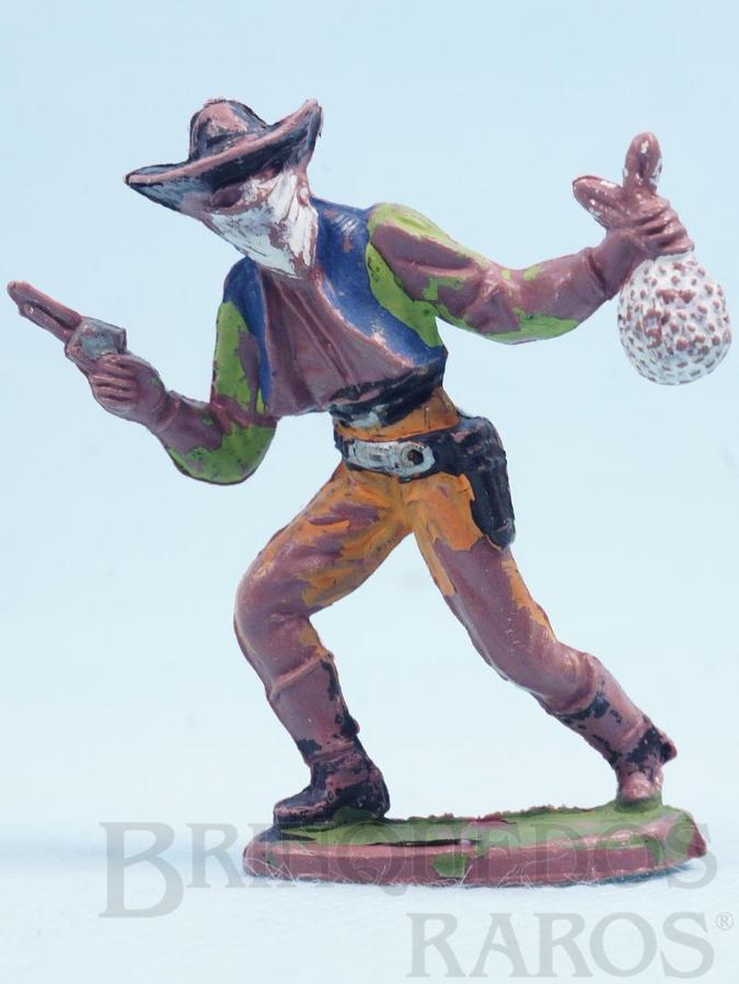 Brinquedo antigo Bandido andando com revolver e saco de dinheiro