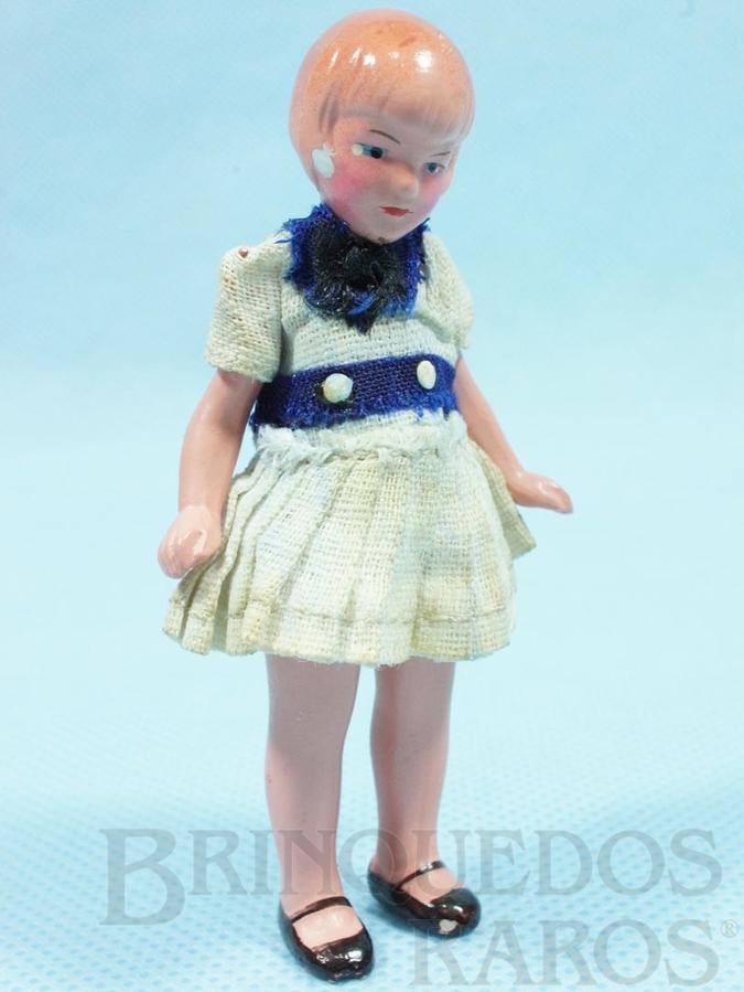 Brinquedo antigo Boneca com 8,00 cm de altura Roupa de tecido Ano 1935