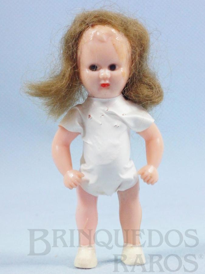 Brinquedo antigo Boneca Estrelinha com 8,00 cm de altura Roupa branca de tecido plástico Olhos pintados Cabelo Natural Ano 1957