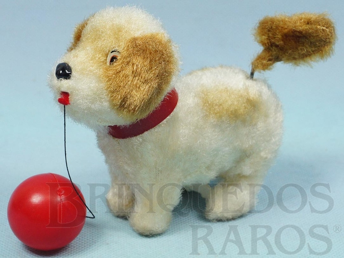 Brinquedo antigo Cachorro com bola 15,00 cm de comprimento Brinca com a bola e abana o rabo Década de 1970