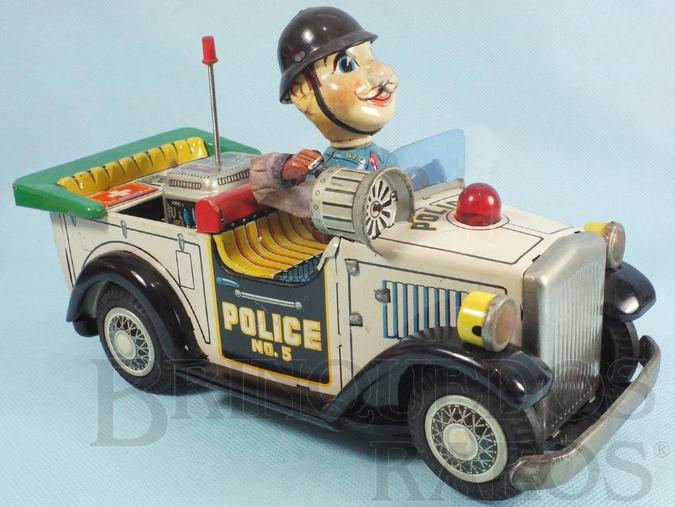 Brinquedo antigo Calhambeque de Policia com Boneco Sistema Bate e  Volta boneco movimenta o braço acionando a Sirene 24,00 cm de comprimento Década de 1960