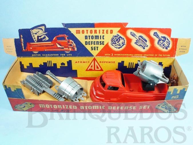 Brinquedo antigo Conjunto Motorized Atomic Defence Set com Caminhão e três Armas intercambiáveis 24,00 cm de comprimento Década de 1950