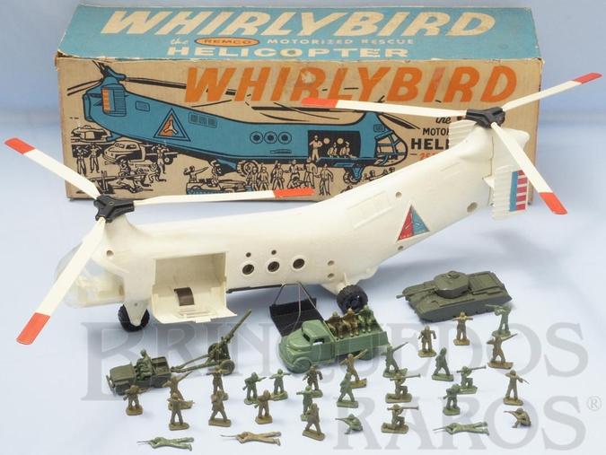Brinquedo antigo Conjunto Whirlybird com Helicóptero de Transporte de Tropas de 65,00 cm de comprimento Movimenta as hélices anda para a frente e tem guincho operacinal Acompanha Jeep com Canhão Tanque de Guerra Caminhão e 35 soldados Década 1960