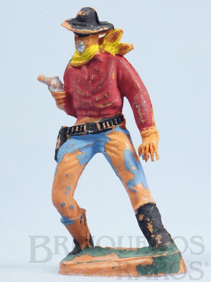 Brinquedo antigo Cowboy de pé atirando com revolver Gulliver Década de 1970