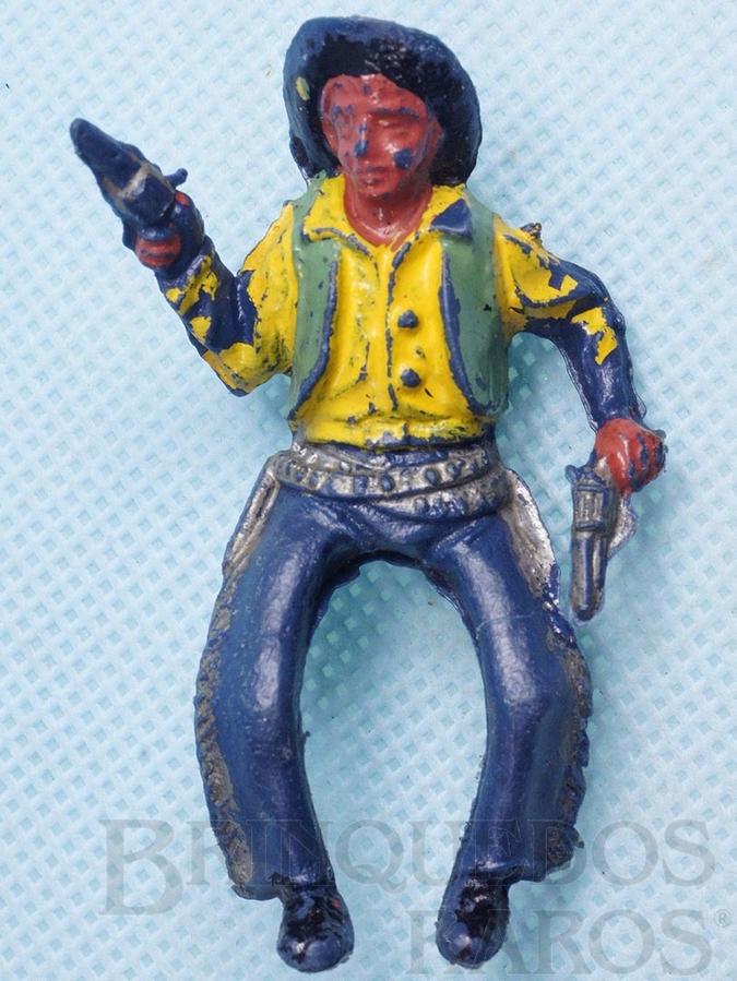 Brinquedo antigo Cowboy montado a cavalo com dois revolveres Plástico azul escuro pintado Década de 1960