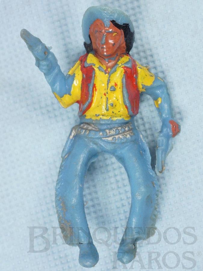 Brinquedo antigo Cowboy montado a cavalo com dois revolveres Plástico azul pintado Década de 1960