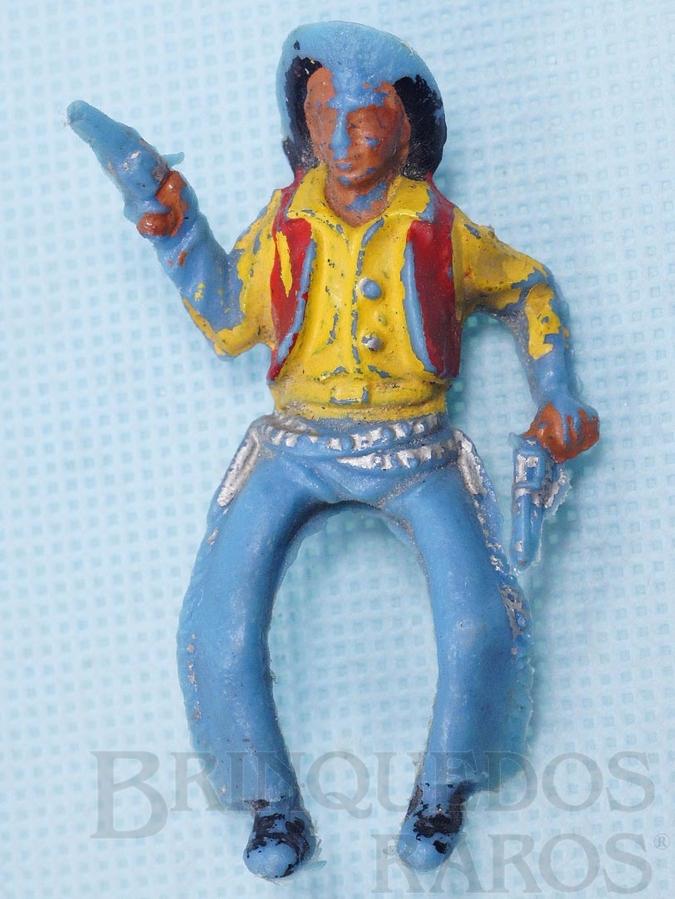 Brinquedo antigo Cowboy montado a cavalo com dois revolveres Plástico azul claro pintado Década de 1960