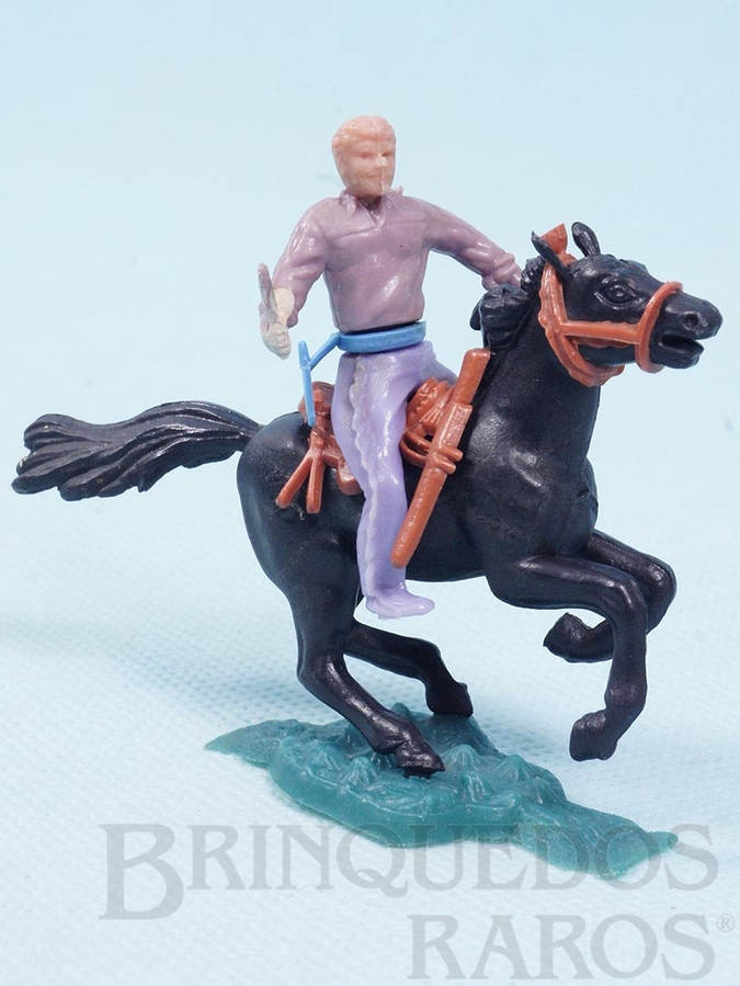 Brinquedo antigo Cowboy montado a cavalo com punhal cópia Timpo Toys Década de 1970