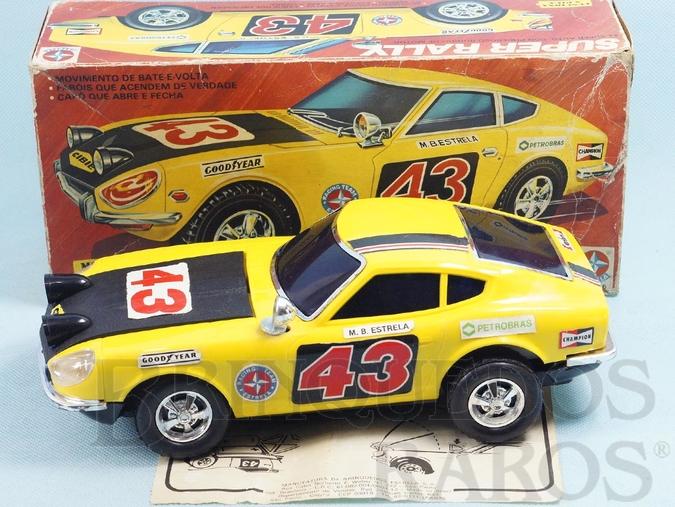 Brinquedo antigo Datsun 240z Super Rally com 26,00 cm de comprimento Sistema Bate e Volta com Farol que acende Ano 1981