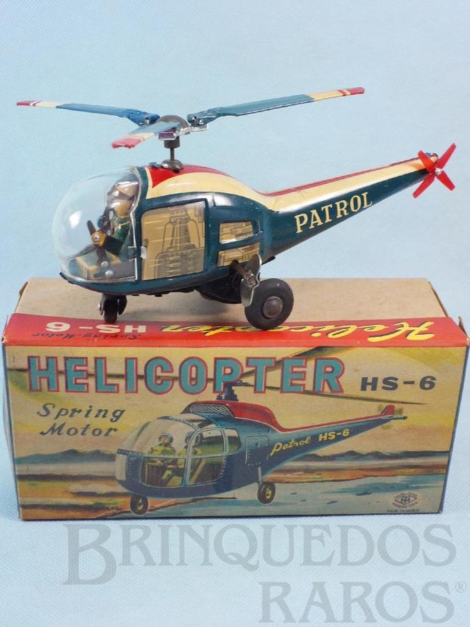 Brinquedo antigo Helicóptero com 21,00 cm de comprimento Conforme gira a hélice o piloto movimenta os braços Ano 1964