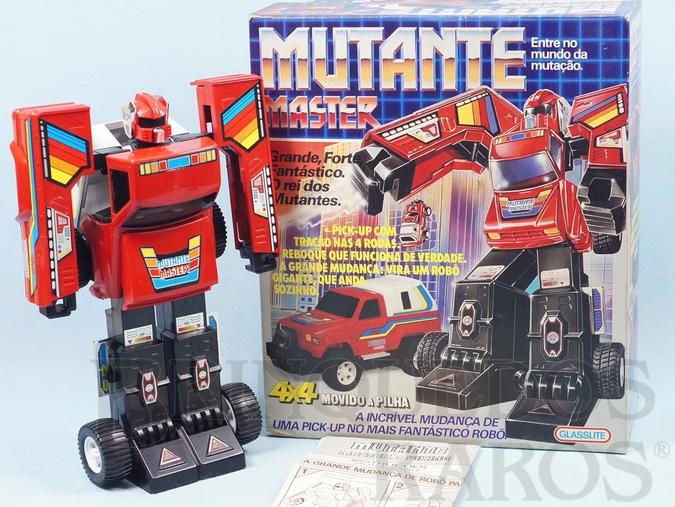 Brinquedo antigo Transformer Mutante Master com 25,00 cm de altura Excelente estado completo com manual Década de 1980