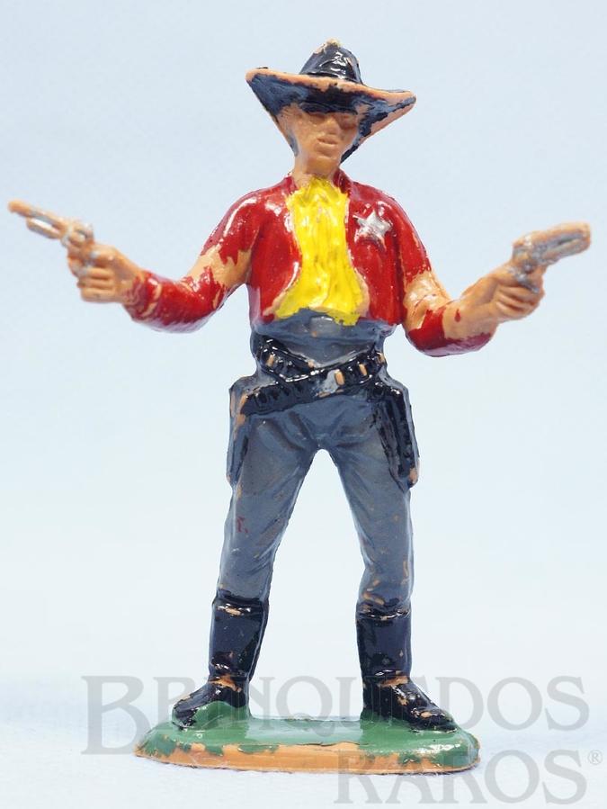 Brinquedo antigo Xerife de pé com dois revolveres