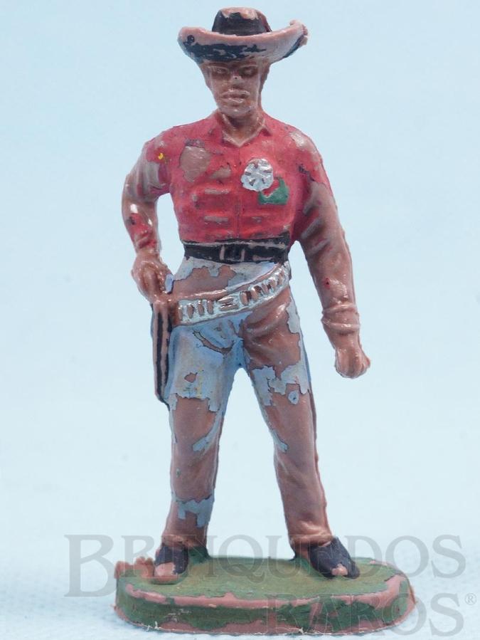 Brinquedo antigo Xerife de pé sacando o revolver